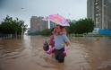 Σοβαρές πλημμύρες πλήττουν την Κίνα [photos] - Φωτογραφία 3